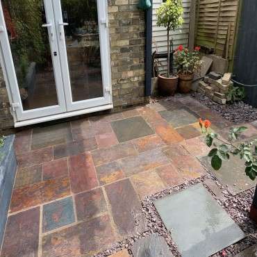 20sqm Pavone with a grey resin joint. A vibrant natural stone laid in a mixed pattern