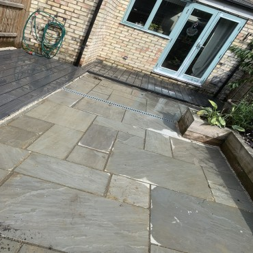 Finishing touches such as leaving planting space in the paving and running the connecting decking makes the perfect finish.