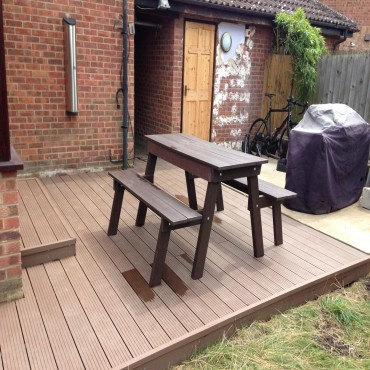 45 sqm recycled composite decking and sub frame with a seamless finish and all screws hidden.