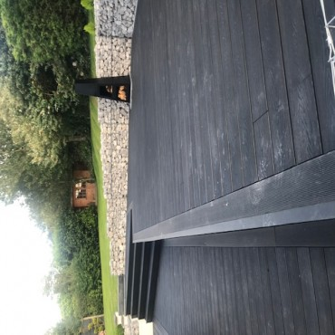 Charcoal decking with natural shade gab-ion
