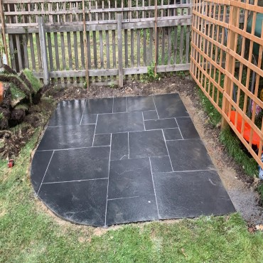 Black limestone with a mid grey joint softened with a curve.